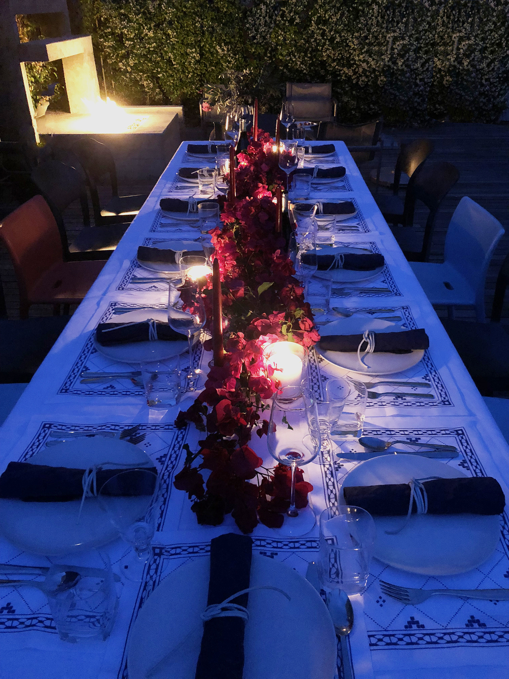 Candlelit Greek dinner party outdoor al fresco blue and white bougainvillea runner