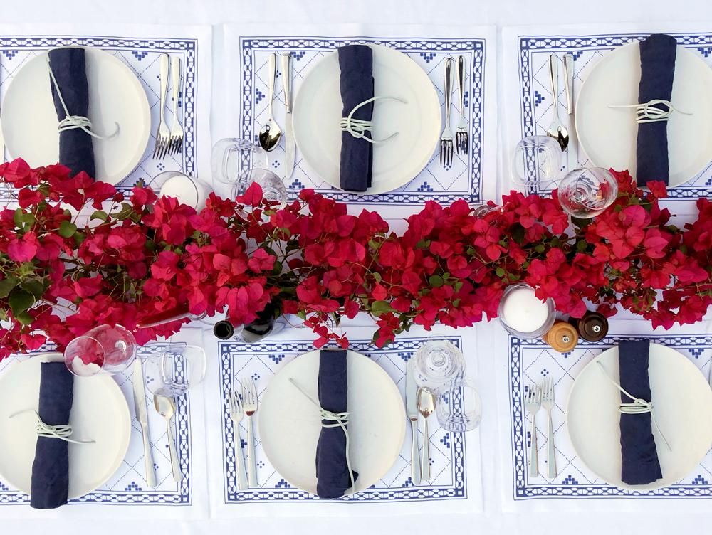 Blue and white placesetting Greek dinner party bougainvillea